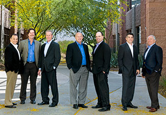 The Renaissance Companies, a full service construction management firm in Scottsdale, wanted to picture their executive team and their corporate headquarters. Large lights were brought in to make the executives standing in the shade pop.